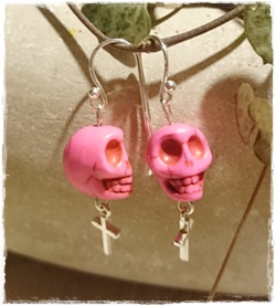 Skull earrings pink
