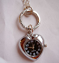 Necklace with heartshaped watch