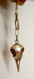 Earring raven skull red eyes