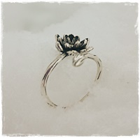 Ring with silver flower