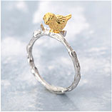 Ring with golden bird