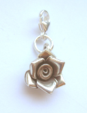 Lock charm with silver flower