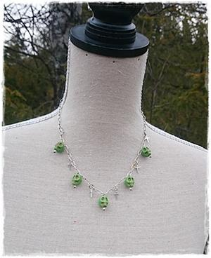 Green skull necklace